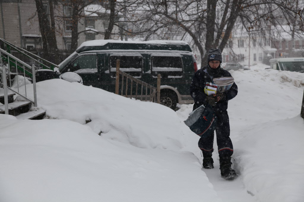 1260190 bytes; 5616 x 3744; Sean Robbins, 32, delivers mail in Bangor during the snowstorm on Thursday.